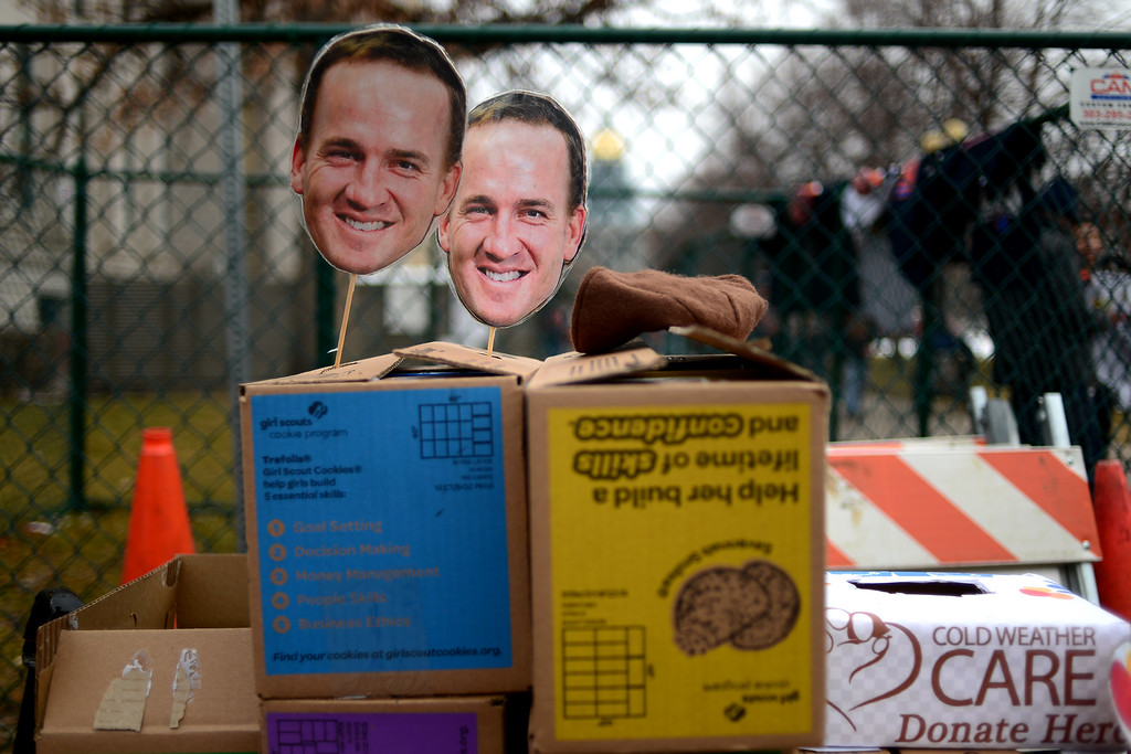 . DENVER, CO. - JANUARY 31: Girls Scouts use Peyton Manning cutouts to help sell cookies during a Denver Broncos fan rally on Sunday January 31, 2016. (Photo By AAron Ontiveroz/The Denver Post)