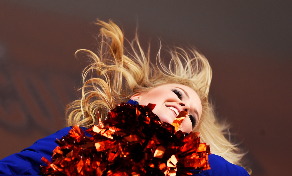 . DENVER, CO - JANUARY 31: A Denver Bronco Cheerleader dances for the crowd  as they celebrate the Denver Broncos heading to Super Bowl 50 during a rally at Civic Center Park in Denver, January, 31, 2016. The Denver Broncos will take on Carolina Panthers at Levi\'s Stadium in Santa Clara, California. (Photo by RJ Sangosti/The Denver Post)