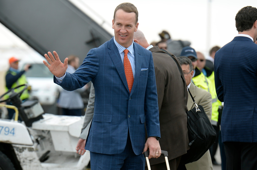 . DENVER, CO - JAN 31: Denver Broncos quarterback Peyton Manning waves to some fans just before boarding the team\'s plane to California. The Denver Broncos depart Denver International Airport on Sunday, Jan. 31, 2016 destined for San Jose, CA. where the team will begin preparations for Super Bowl 50 on Feb. 7, 2016.(Photo by Kathryn Scott Osler/The Denver Post)