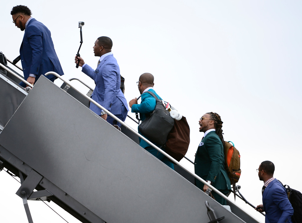 . DENVER, CO - JAN 31: Running back Juwan Thompson uses a camera on a selfie stick as The Denver Broncos climb stairs boarding a United plane that will fly them to California. The Denver Broncos depart Denver International Airport on Sunday, Jan. 31, 2016 destined for San Jose, CA. where the team will begin preparations for Super Bowl 50 on Feb. 7, 2016.(Photo by Kathryn Scott Osler/The Denver Post)