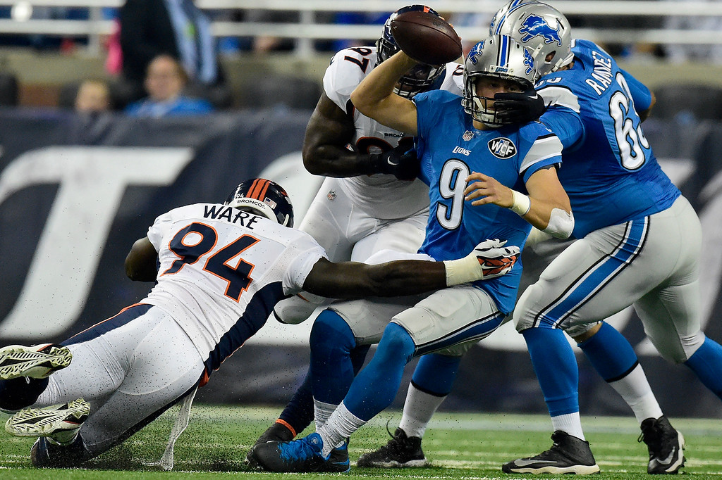 . DETROIT, MI - SEPTEMBER 27: DeMarcus Ware (94) of the Denver Broncos and Malik Jackson (97) sack Matthew Stafford (9) of the Detroit Lions during the first half of play at Ford Field. The Detroit Lions hosted the Denver Broncos in NFL week 3 action on Sunday, September 27, 2015. (Photo by AAron Ontiveroz/The Denver Post)
