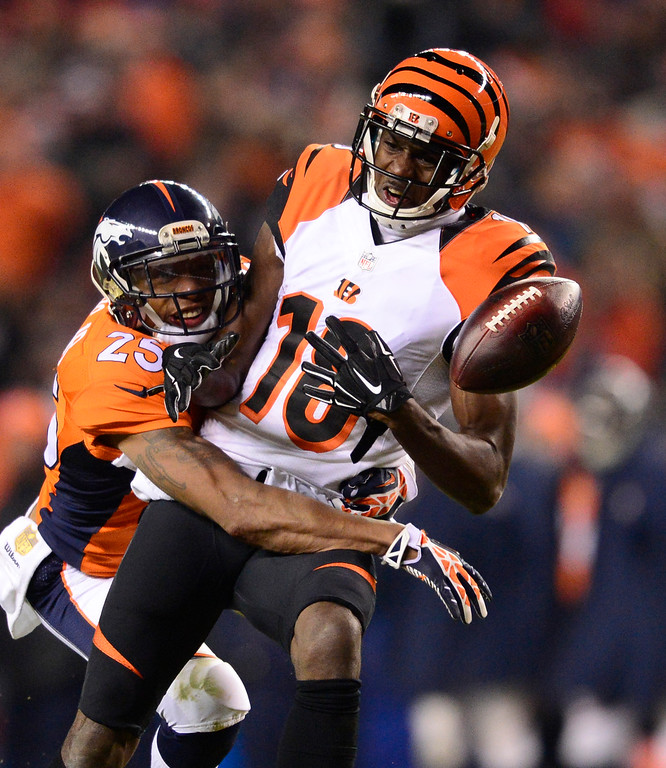 . DENVER, CO - DECEMBER 28: Denver Broncos cornerback Chris Harris (25) knocks a pass away intended for Cincinnati Bengals wide receiver A.J. Green (18) during the fourth quarter December 28, 2015 at Sports Authority Field at Mile High Stadium. (Photo By Eric Lutzens/The Denver Post)