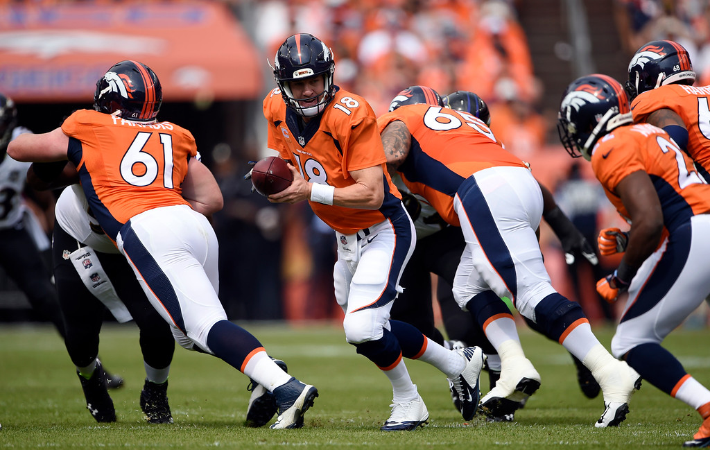 . Peyton Manning (18) of the Denver Broncos looks for a hand off to C.J. Anderson (22) of the Denver Broncos during the first quarter.  The Denver Broncos played the Baltimore Ravens at Sports Authority Field at Mile High in Denver, CO on September 13, 2015. (Photo by Joe Amon / The Denver Post)