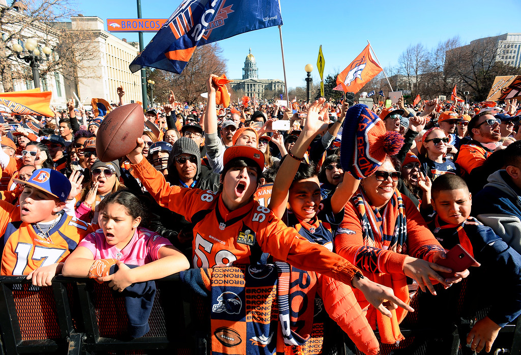 . DENVER, CO - JANUARY 9:  Broncos fans D\'Artagnan Devereux, with ball, and his friend Rene Navarro, third from right, both 16 of Westminster, cheer as the Peyton Manning is introduced on stage  during the Denver Broncos Super Bowl 50 victory rally in Civic Center Park on February 9, 2016 in Denver, Colorado.   (Photo by Helen H. Richardson/The Denver Post)