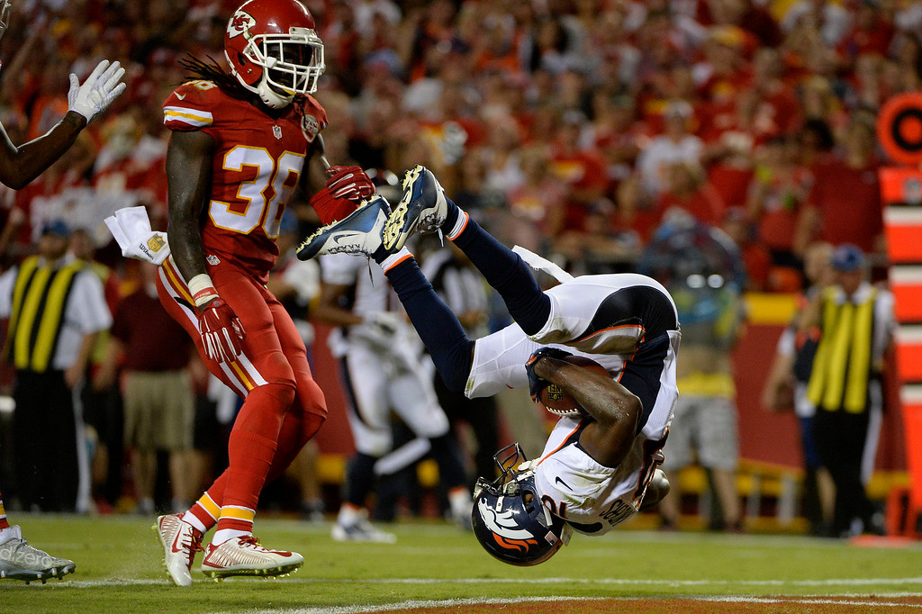 . KANSAS CITY, MO - SEPTEMBER 17: Wide receiver Emmanuel Sanders (10) of the Denver Broncos dives into the intone for six against the Kansas City Chiefs during the first half of play at Arrowhead Stadium. The Kansas City Chiefs hosted the Denver Broncos on Thursday, September 17, 2015. (Photo by AAron Ontiveroz/The Denver Post)