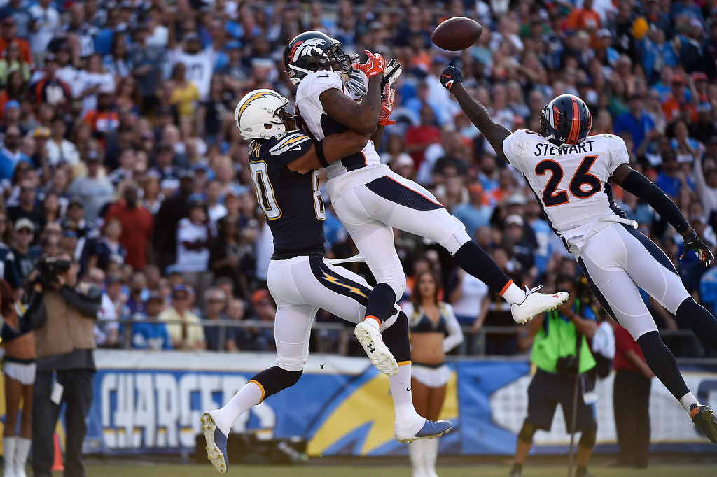 . Cornerback Aqib Talib #21 of the Denver Broncos and free safety Darian Stewart #26 break up a pass in the end zone to wide receiver Malcom Floyd #80 of the San Diego Chargers Qualcomm Stadium. San Diego, CA. December 06, 2015 (Photo by Joe Amon/The Denver Post)