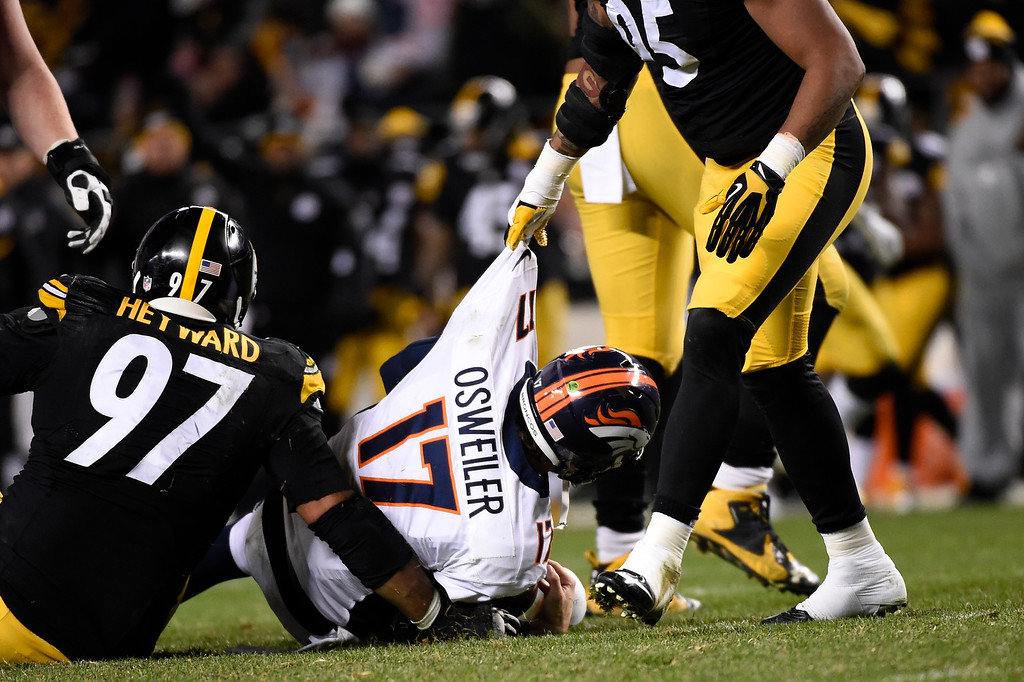 . PITTSBURGH, PA - DECEMBER 20:  Denver Broncos quarterback Brock Osweiler #17 is sacked by Pittsburgh Steelers defensive end Cameron Heyward #97 and outside linebacker Jarvis Jones #95 in the second half at Heinz Field in Pittsburgh, PA, December 20, 2015 (Photo By Joe Amon/The Denver Post)