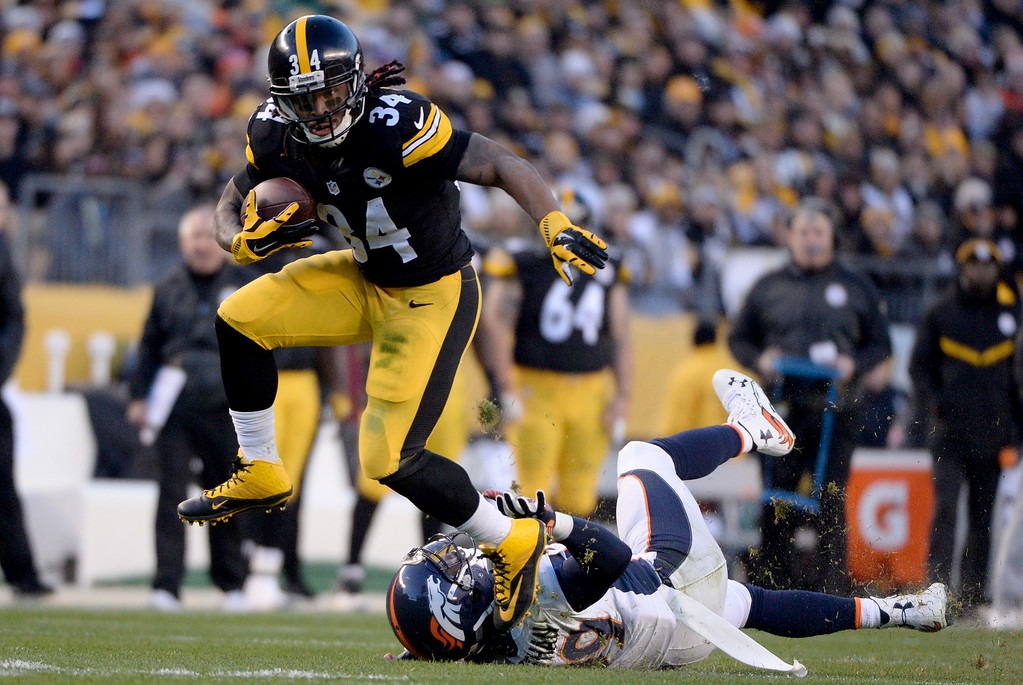 . DeAngelo Williams (34) of the Pittsburgh Steelers trucks Danny Trevathan (59) of the Denver Broncos during the first half of play at Heinz Field. The Pittsburgh Steelers hosted the Denver Broncos on Sunday, December 20, 2015. (Photo by AAron Ontiveroz/The Denver Post)
