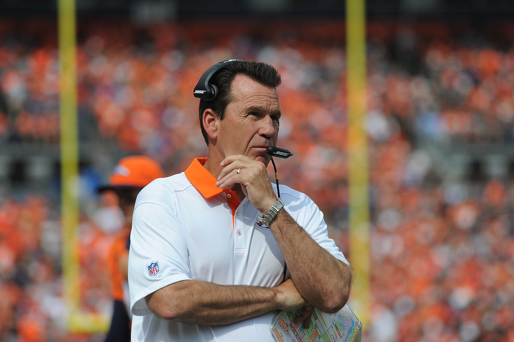 . Denver Broncos head coach Gary Kubiak watches a replay on the big screen in the first half against the Baltimore Ravens at Sports Authority Field at Mile High on September 13, 2015. (Photo by Steve Nehf/The Denver Post)