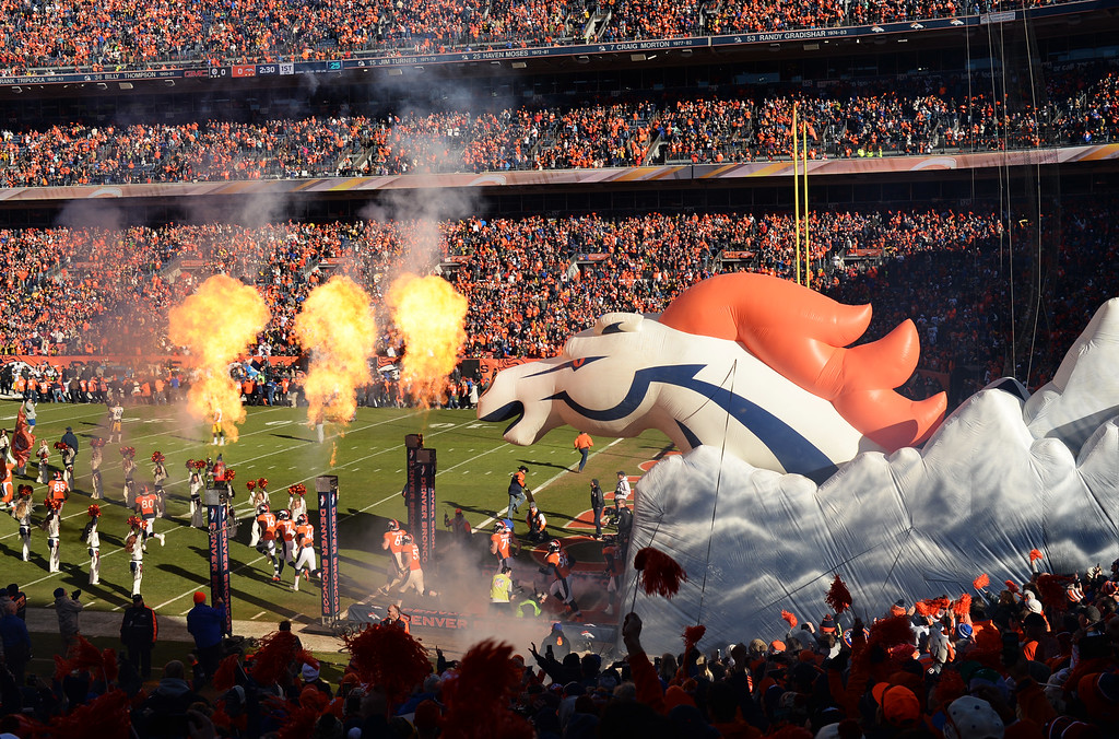 . DENVER, CO - JANUARY 17: Denver Broncos take the field at Sports Authority Field at Mile High, January, 17, 2016. The Denver Broncos take on Pittsburgh Steelers during AFC division playoff game. (Photo by RJ Sangosti/The Denver Post)