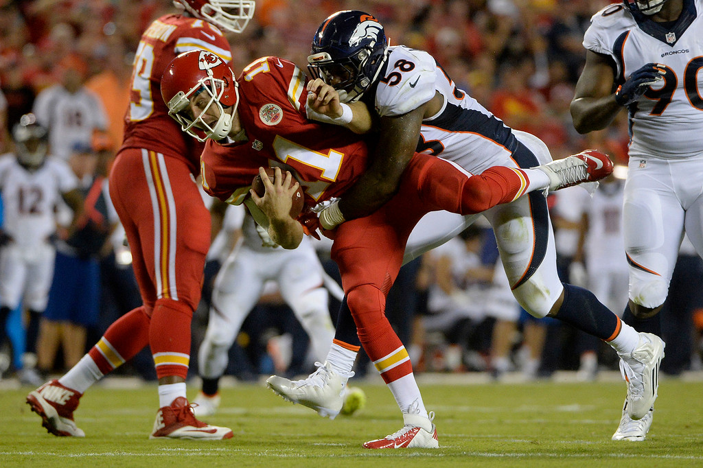 . KANSAS CITY, MO - SEPTEMBER 17: Outside linebacker Von Miller (58) of the Denver Broncos racks up a personal foul as he lays out quarterback Alex Smith (11) of the Kansas City Chiefs after the ball was blown dead during the first half of play at Arrowhead Stadium. The Kansas City Chiefs hosted the Denver Broncos on Thursday, September 17, 2015. (Photo by AAron Ontiveroz/The Denver Post)
