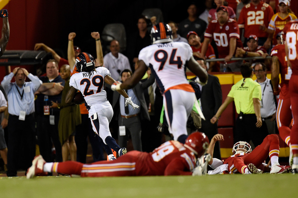 . KANSAS CITY, MO - SEPTEMBER 17: Cornerback Bradley Roby (29) of the Denver Broncos scores the game-winning touchdown as Chiefs players lay on the field during the second half of the Broncos\' 31-24 win at Arrowhead Stadium. The Kansas City Chiefs hosted the Denver Broncos on Thursday, September 17, 2015. (Photo by AAron Ontiveroz/The Denver Post)