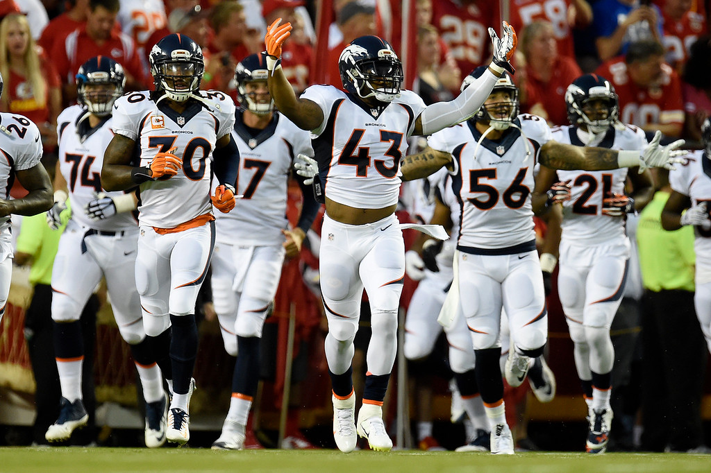 . T.J. Ward (43) of the Denver Broncos leads the team out before the  the first half of play at Arrowhead Stadium. The Kansas City Chiefs hosted the Denver Broncos on Thursday, September 17, 2015. (Photo by AAron Ontiveroz/The Denver Post)