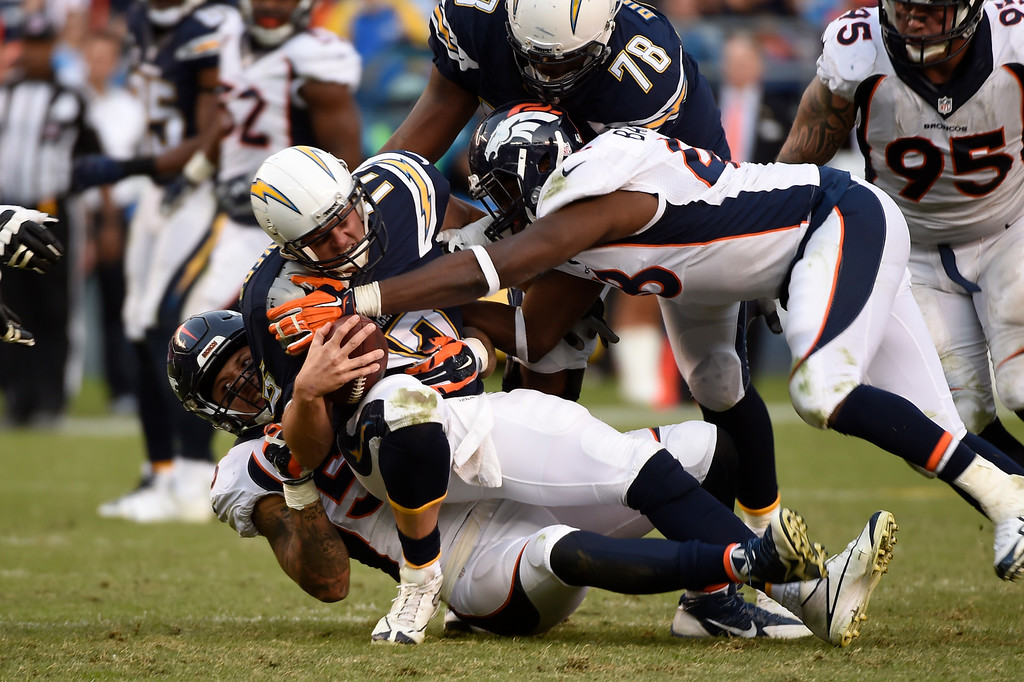 . linebacker Shane Ray #56 of the Denver Broncos and outside linebacker Shaquil Barrett #48 make the last sack of the day of quarterback Philip Rivers #17 of the San Diego Chargers at Qualcomm Stadium. San Diego, CA. December 06, 2015 (Photo by Joe Amon/The Denver Post)