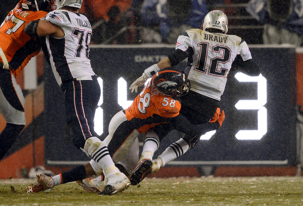 . Denver Broncos outside linebacker Von Miller (58) sacks New England Patriots quarterback Tom Brady (12) during overtime November 29, 2015 at Sports Authority Field at Mile High Stadium. (Photo By Helen H. Richardson/The Denver Post)