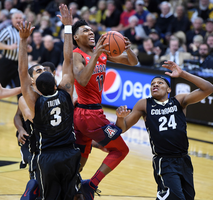 . Arizona guard Allonzo Trier drives past Colorado\'s Xavier Talton (3) and George King during the first half of an NCAA college basketball game Wednesday, Feb. 24, 2016, in Boulder, Colo. (AP Photo/Cliff Grassmick)