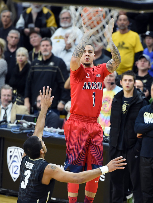 . Arizona guard Gabe York shoots over Colorado\'s Xavier Talton during the first half of an NCAA college basketball game Wednesday, Feb. 24, 2016, in Boulder, Colo. (AP Photo/Cliff Grassmick)
