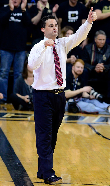 . Caption: Arizona coach Sean Miller signals his players during the first half of the team\'s NCAA college basketball game against Arizona on Wednesday, Feb. 24, 2016, in Boulder, Coio. (AP Photo/Cliff Grassmick)