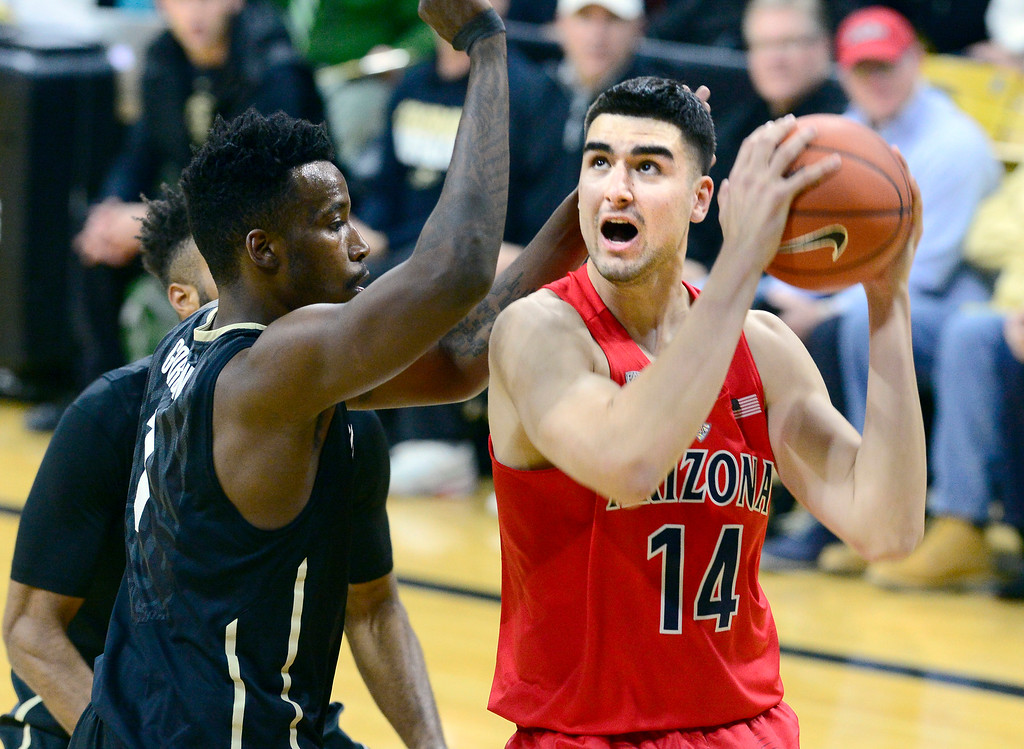 . Arizona center Dusan Ristic looks to shoot over Colorado\'s Wesley Gordon during the first half of an NCAA college basketball game Wednesday, Feb. 24, 2016, in Boulder, Coio. (AP Photo/Cliff Grassmick)