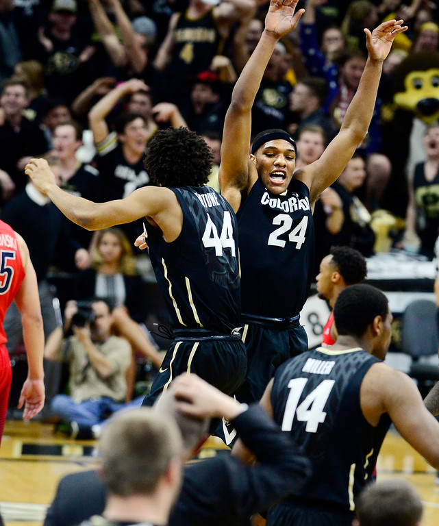 . Colorado\'s Josh Fortune, left, and George King celebrate a basket against Arizona during the second of an NCAA college basketball game Wednesday, Feb. 24, 2016, in Boulder, Colo. Colorado won 75-72. (AP Photo/Cliff Grassmick)