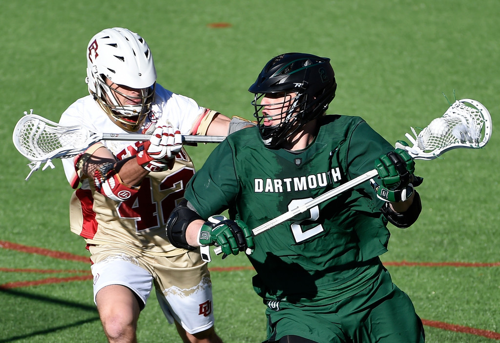 . DENVER, CO - FEBRUARY 28: Dartmouth Jack Korzelius (2) woks the ball around as he gets pressure from Denver Nick Phillips (42) in the fourth period during the Face-off Classic February 28, 2016 at Peter Barton Lacrosse Stadium. (Photo By John Leyba/The Denver Post)