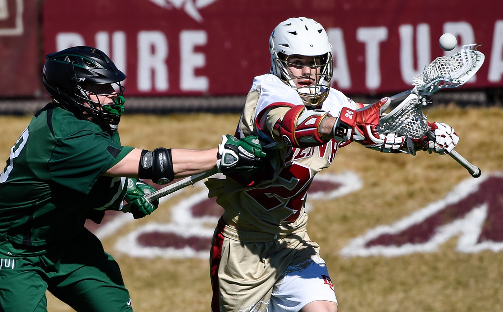 . DENVER, CO - FEBRUARY 28: Denver Connor Donahue (24) controls the ball from Dartmouth Max Randall (28) during the Face-off Classic February 28, 2016 at Peter Barton Lacrosse Stadium. (Photo By John Leyba/The Denver Post)