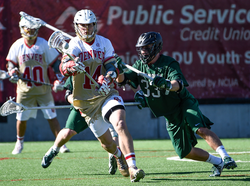. DENVER, CO - FEBRUARY 28: Dartmouth Austin Duncan (33) puts pressure on Denver Jeremy Bosher (14) during the Face-off Classic February 28, 2016 at Peter Barton Lacrosse Stadium. (Photo By John Leyba/The Denver Post)