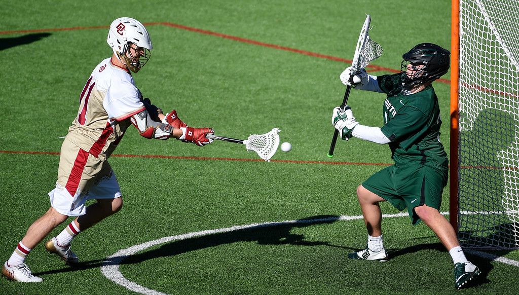 . DENVER, CO - FEBRUARY 28: Denver Jack Bobzien (11) takes a shot on goalie Dartmouth Joe Balaban (34) for a score in the third period during the Face-off Classic February 28, 2016 at Peter Barton Lacrosse Stadium. (Photo By John Leyba/The Denver Post)