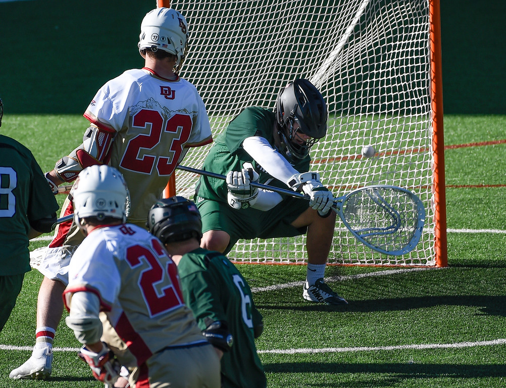 . DENVER, CO - FEBRUARY 28: Dartmouth Joe Balaban (34) can\'t make a save on a shot and goal by Denver Max Planning (22) in the fourth period during the Face-off Classic February 28, 2016 at Peter Barton Lacrosse Stadium. (Photo By John Leyba/The Denver Post)
