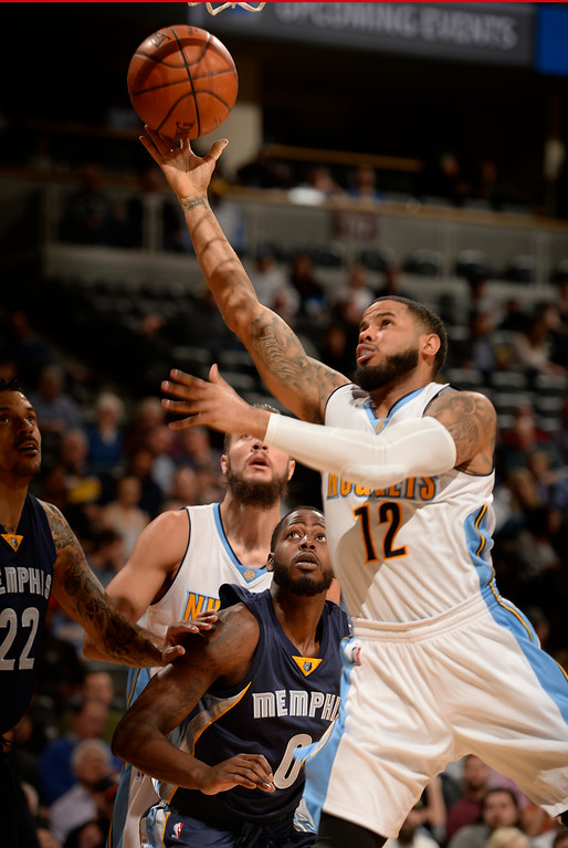 . DENVER, CO - FEBRUARY 29: Denver Nuggets guard D.J. Augustin (12) goes up for an easy layup past Memphis Grizzlies forward JaMychal Green (0) February 29, 2016 at Pepsi Center. (Photo By John Leyba/The Denver Post)