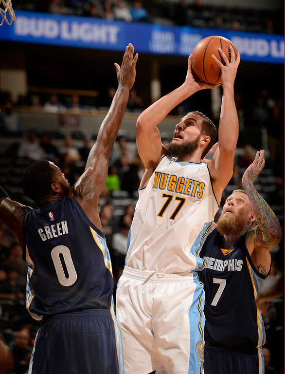 . DENVER, CO - FEBRUARY 29: Denver Nuggets center Joffrey Lauvergne (77) takes a shot over Memphis Grizzlies forward JaMychal Green (0) February 29, 2016 at Pepsi Center. (Photo By John Leyba/The Denver Post)