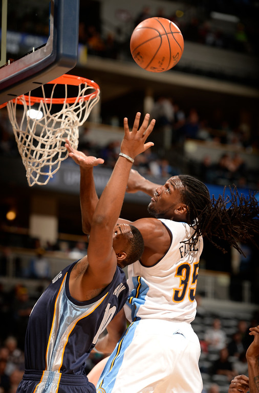 . DENVER, CO - FEBRUARY 29: Denver Nuggets forward Kenneth Faried (35) battles for a rebound with Memphis Grizzlies forward Jarell Martin (10) during the third quarter February 29, 2016 at Pepsi Center. (Photo By John Leyba/The Denver Post)