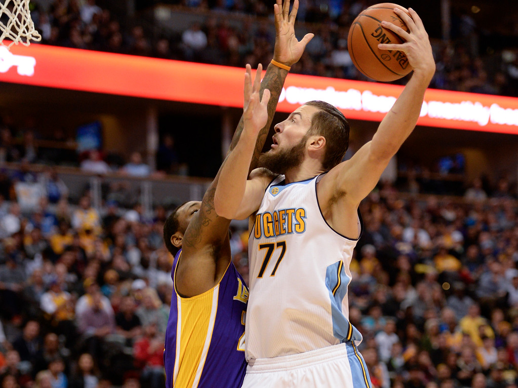 . DENVER, CO - MARCH 2: Denver Nuggets center Joffrey Lauvergne (77) takes a shot over Los Angeles Lakers center Tarik Black (28) March 2, 2016 at Pepsi Center. (Photo By John Leyba/The Denver Post)