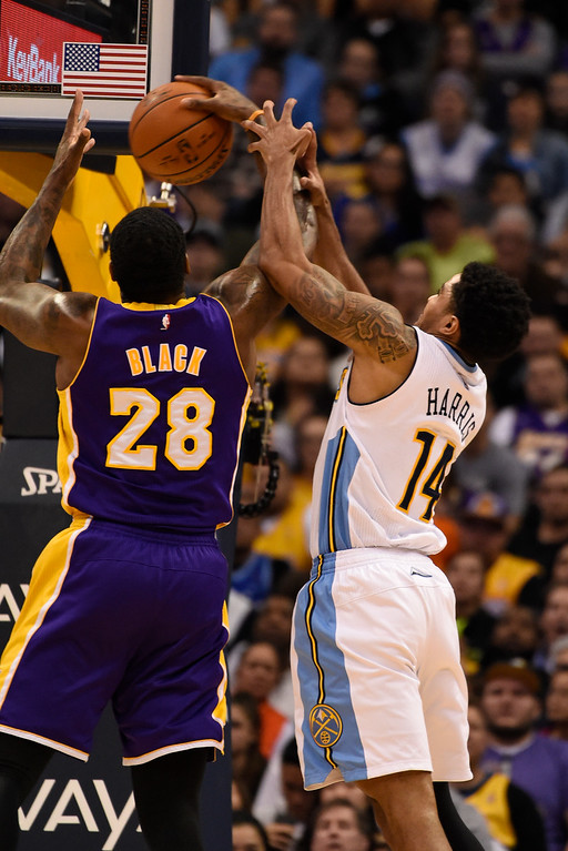 . DENVER, CO - MARCH 02: Denver Nuggets guard Gary Harris (14) battles for a rebound with Los Angeles Lakers center Tarik Black (28) March 2, 2016 at Pepsi Center. (Photo By John Leyba/The Denver Post)