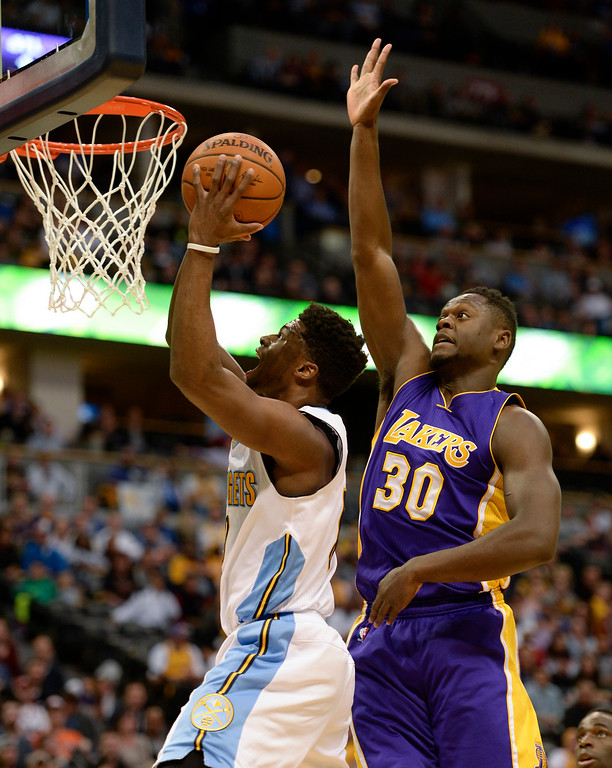 . DENVER, CO - MARCH 2: Denver Nuggets guard Emmanuel Mudiay (0) drives to basket past Los Angeles Lakers forward Julius Randle (30) for an easy basket March 2, 2016 at Pepsi Center. (Photo By John Leyba/The Denver Post)