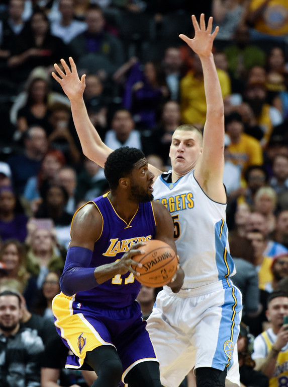 . DENVER, CO - MARCH 02: Los Angeles Lakers center Roy Hibbert (17) looks to take the a shot on Denver Nuggets center Nikola Jokic (15) during their game March 2, 2016 at Pepsi Center. (Photo By John Leyba/The Denver Post)
