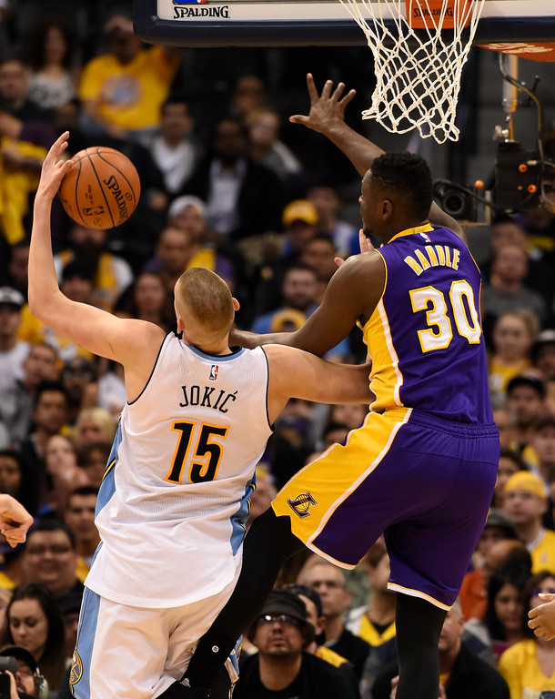 . DENVER, CO - MARCH 02: Denver Nuggets center Nikola Jokic (15) and Los Angeles Lakers forward Julius Randle (30) battle for a rebound March 2, 2016 at Pepsi Center. (Photo By John Leyba/The Denver Post)