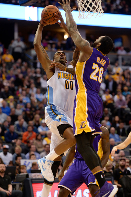 . DENVER, CO - MARCH 2: Los Angeles Lakers center Tarik Black (28) blocks a shot by Denver Nuggets forward Darrell Arthur (00) March 2, 2016 at Pepsi Center. (Photo By John Leyba/The Denver Post)