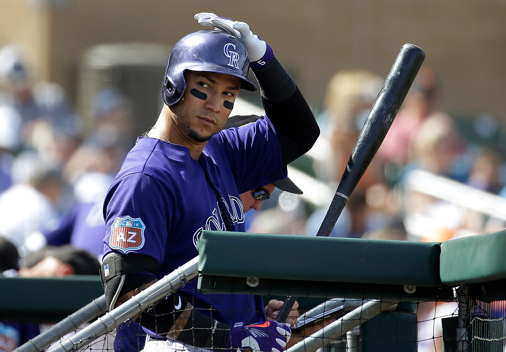 . Colorado Rockies\' Carlos Gonzalez prepares to walk to the on-deck circle during the third inning of the team\'s spring training baseball game against the Milwaukee Brewers in Scottsdale, Ariz., Tuesday, March 22, 2016. (AP Photo/Jeff Chiu)