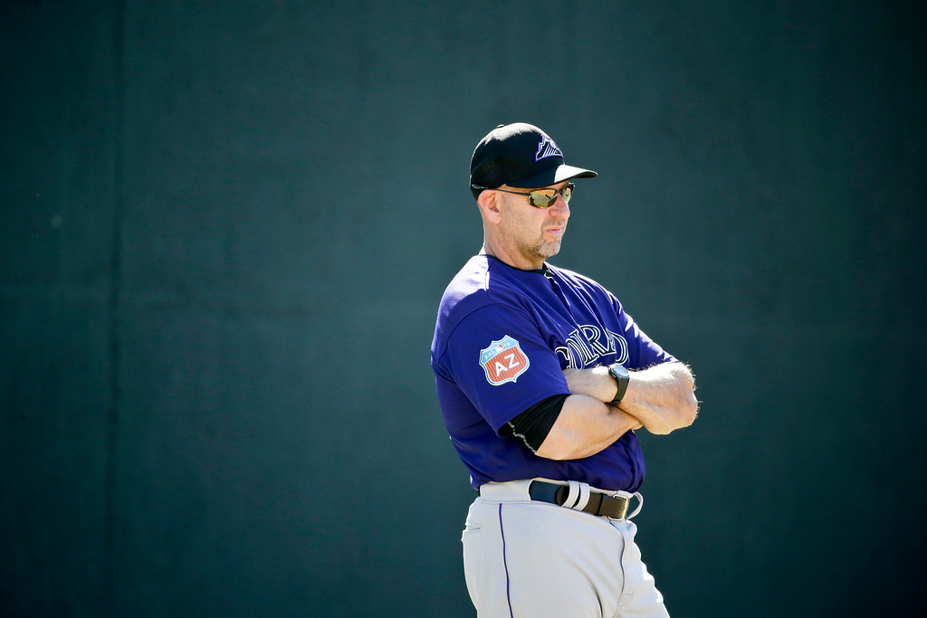 . Colorado Rockies manager Walt Weiss  watches during spring training baseball practice in Scottsdale, Ariz., Monday, Feb. 22, 2016. (AP Photo/Chris Carlson)