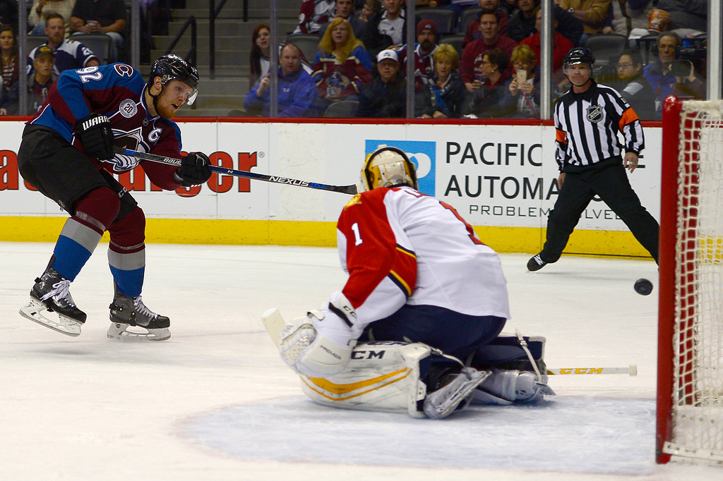. DENVER, CO - MARCH 3: Colorado Avalanche left wing Gabriel Landeskog (92) shoots and scores around the defense of Florida Panthers goalie Roberto Luongo (1) during the first period at the Pepsi Center on March 3, 2016 in Denver, Colorado. (Photo by Brent Lewis/The Denver Post)