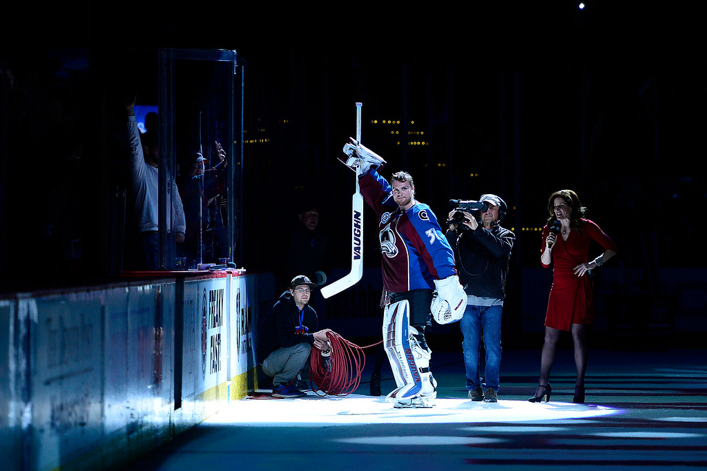 . DENVER, CO - MARCH 3: Colorado Avalanche goalie Calvin Pickard (31) celebrates with the crowd after being names player of the game at the Pepsi Center on March 3, 2016 in Denver, Colorado. The Colorado Avalanche defeated the Florida Panthers 3-2. (Photo by Brent Lewis/The Denver Post)