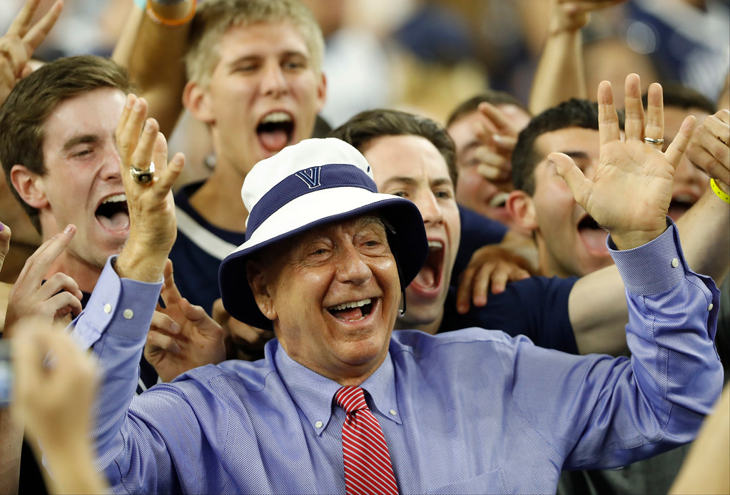 . Sportscaster Dick Vitale poses with Villanova fans before the NCAA Final Four tournament college basketball championship game between Villanova and North Carolina, Monday, April 4, 2016, in Houston. (AP Photo/Eric Gay)