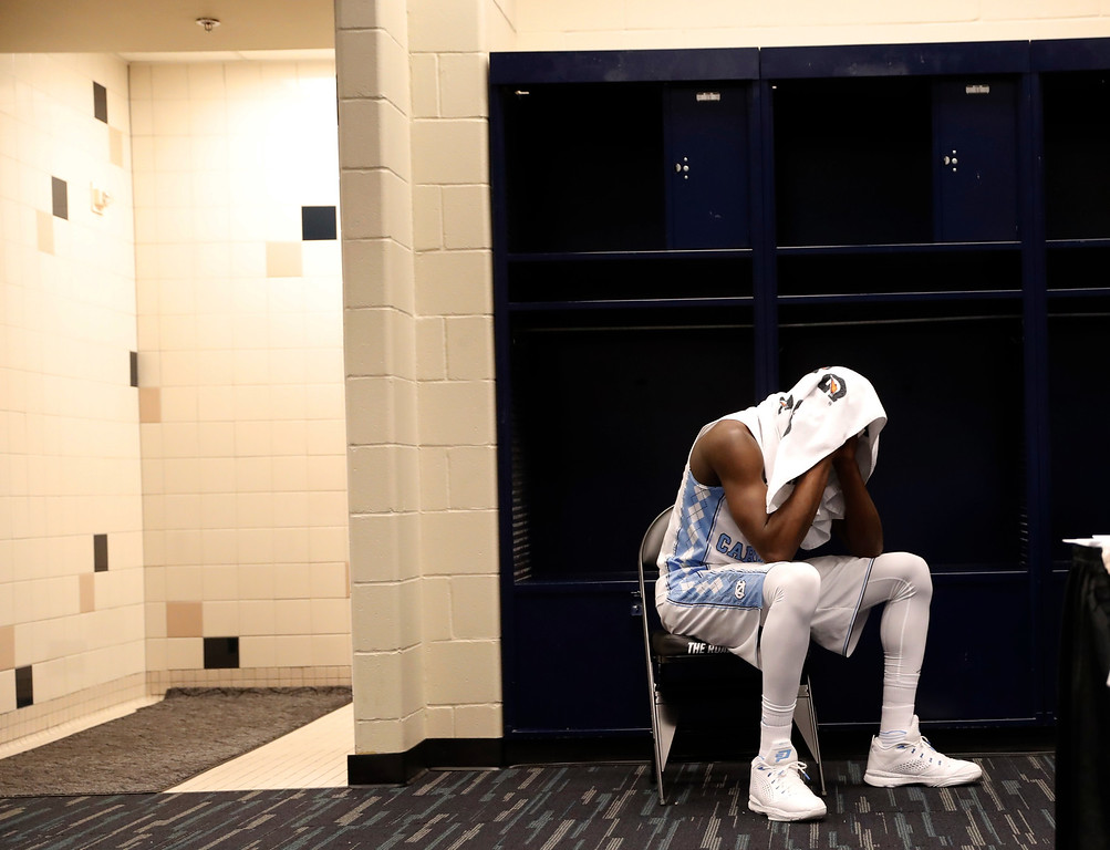 . North Carolina\'s Theo Pinson sits in the locker room after the NCAA Final Four tournament college basketball championship game against Villanova, Monday, April 4, 2016, in Houston. Villanova won 77-74. (AP Photo/Eric Gay)
