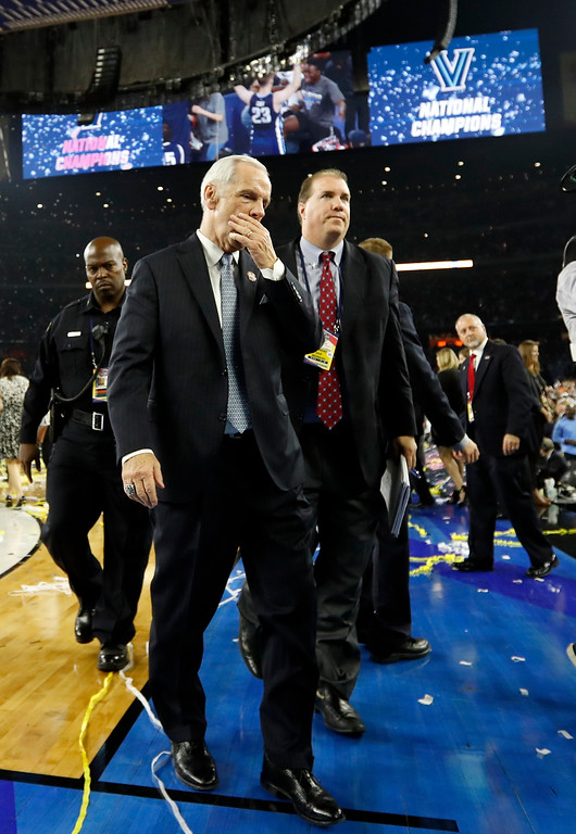 . North Carolina head coach Roy Williams walks off the court after the NCAA Final Four tournament college basketball championship game Monday, April 4, 2016, in Houston. Villanova won 77-74. (AP Photo/Eric Gay)
