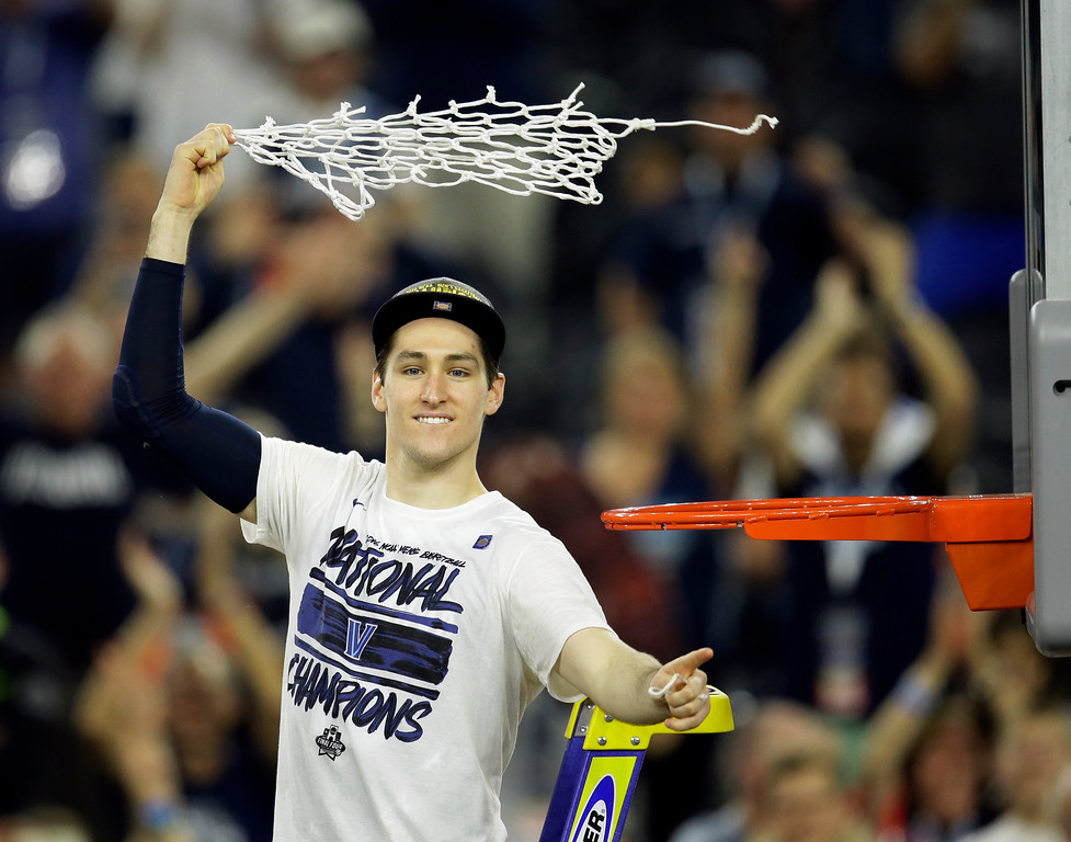 . Villanova\'s Ryan Arcidiacono celebrates after cutting down the net after the NCAA Final Four tournament college basketball championship game Monday, April 4, 2016, in Houston. Villanova won 77-74. (AP Photo/Charlie Neibergall)