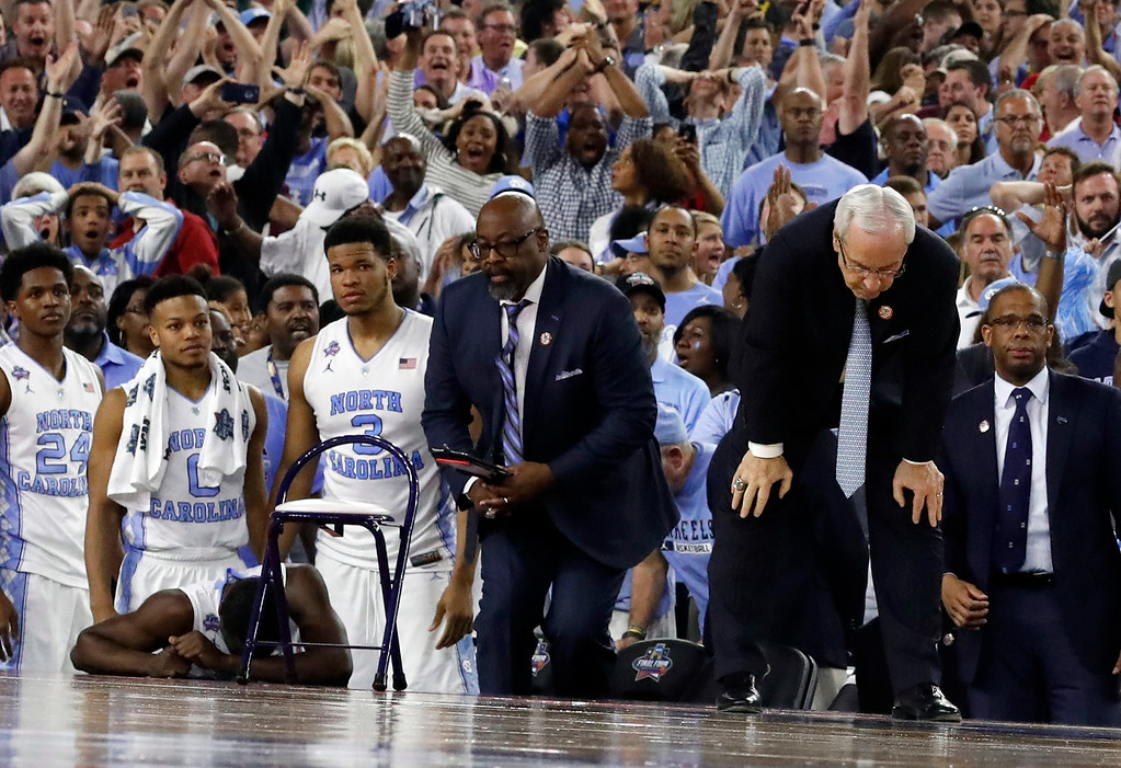 . North Carolina head coach Roy Williams, right and his players on the bench react after the NCAA Final Four tournament college basketball championship game against Villanova, Monday, April 4, 2016, in Houston. Villanova won 77-74. (AP Photo/David J. Phillip)