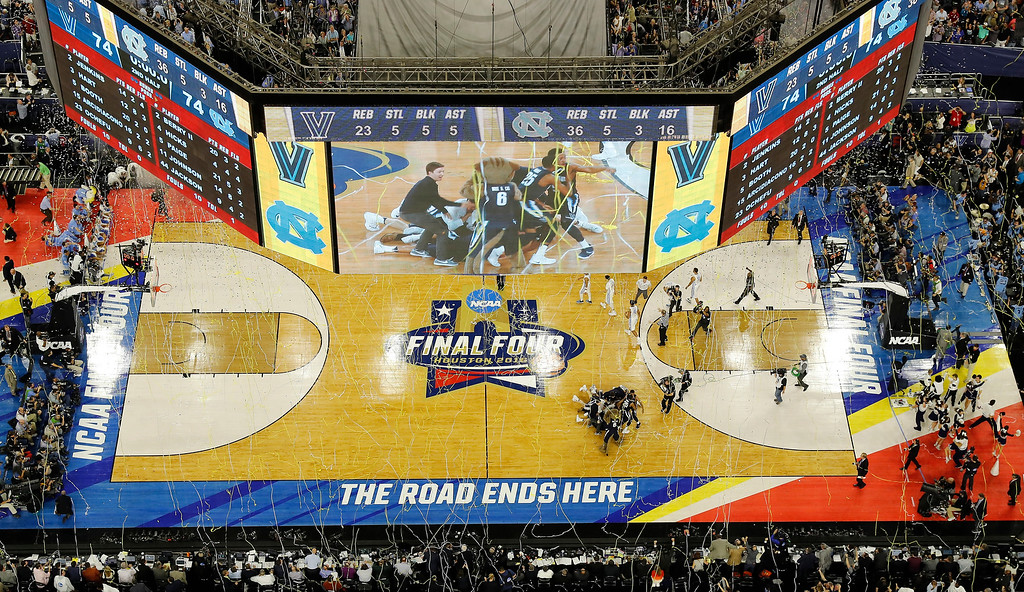 . Villanova players collapse on the court after the NCAA Final Four tournament college basketball championship game against North Carolina, Monday, April 4, 2016, in Houston. Villanova won 77-74. (AP Photo/Morry Gash)