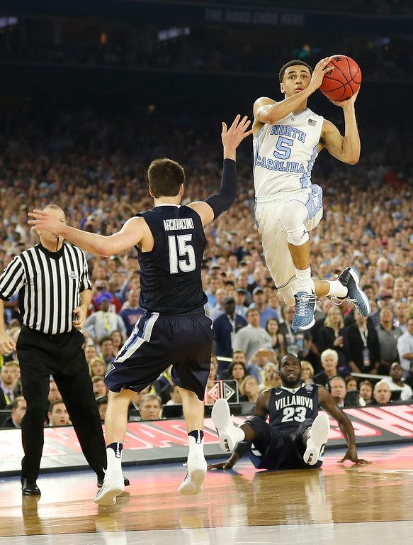 . North Carolina guard Marcus Paige (5) shoots over Villanova guard Ryan Arcidiacono (15) during the second half of the NCAA Final Four tournament college basketball championship game Monday, April 4, 2016, in Houston. (AP Photo/David J. Phillip)