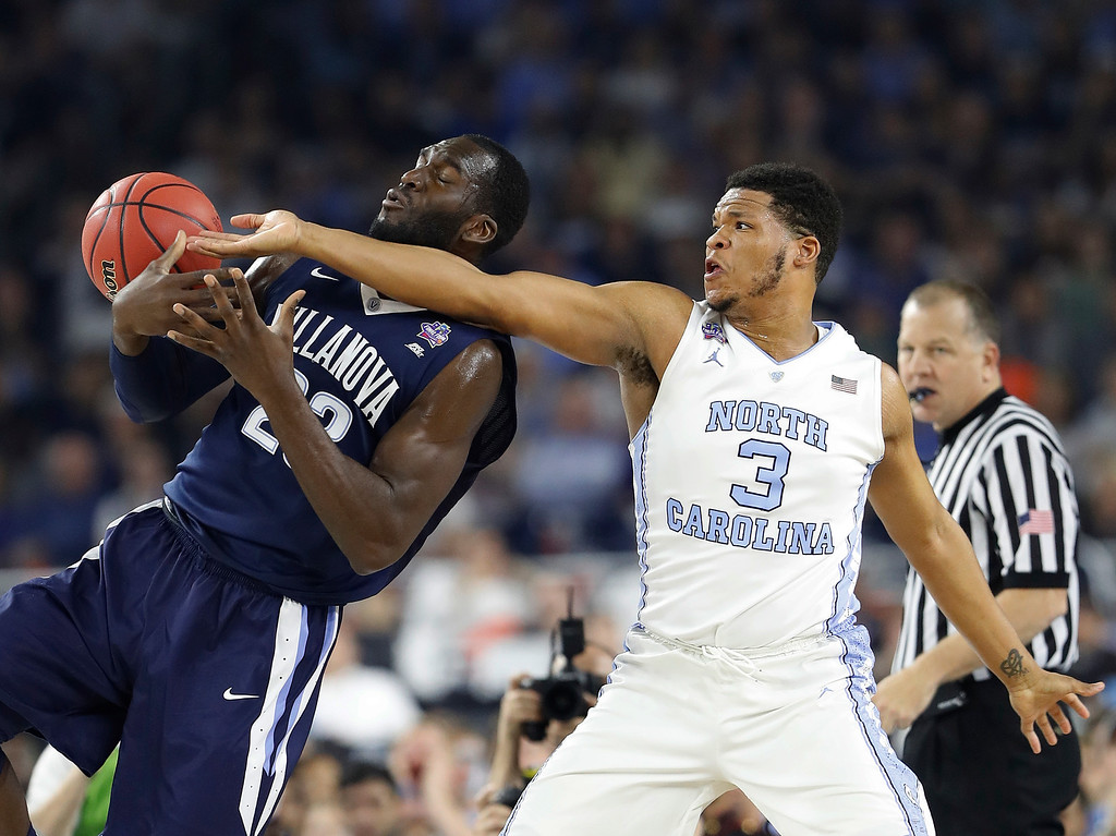 . Villanova\'s Daniel Ochefu (23) and North Carolina\'s Kennedy Meeks (3) battle for a rebound during the first half of the NCAA Final Four tournament college basketball championship game Monday, April 4, 2016, in Houston. (AP Photo/Eric Gay)